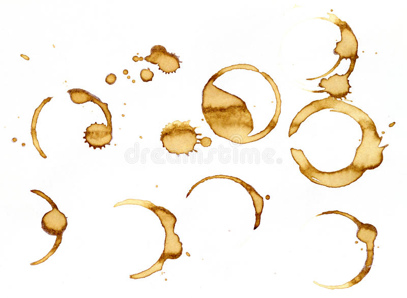 Coffee stains. A couple of different cup stains isolated on white stock image