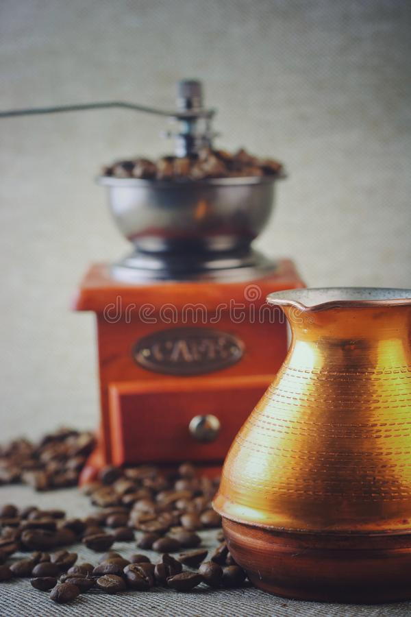 Coffee still life with wooden vintage grinder, Cezve, cup and coffee beans stock image