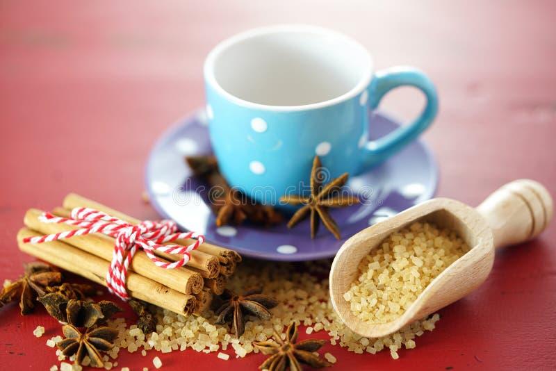 Coffee sugar, cinnamon and star anise coffee sweetener macro closeup. On vintage red wood table, selective focus stock photos