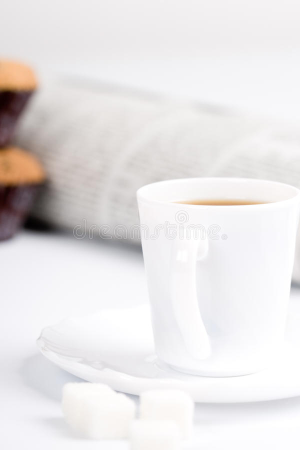Coffee, sugar, muffins and newspapers. Cup of coffee, sugar, muffins and stack of newspapers closeup stock photography