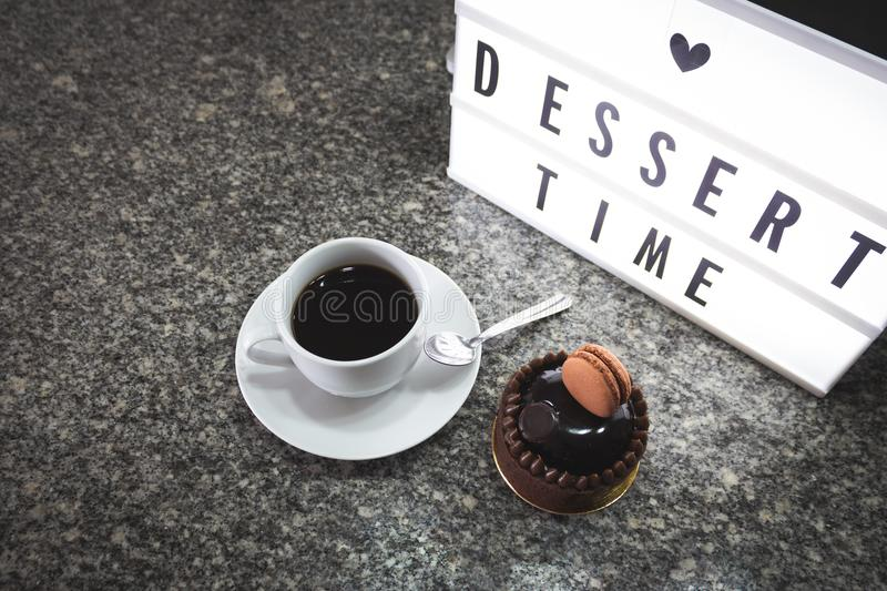 Coffee and sweet chocolate dessert. Sweet chocolate and coffee dessert in a granite table, with cool light boox, dessert time, love sweet stock photography