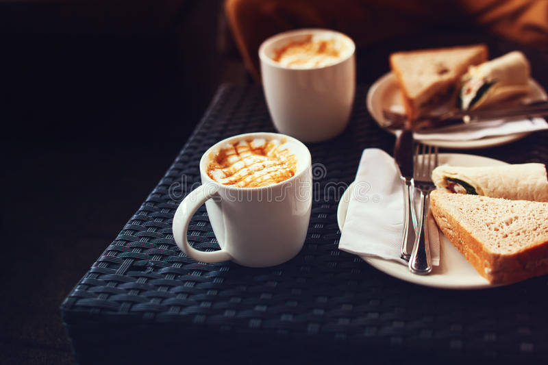 Coffee on table in cafe with some toast. Breakfast or coffee break background with copy space royalty free stock photo