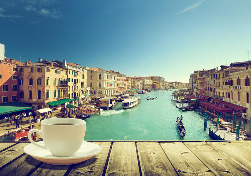 Coffee on table and Venice in sunset time. Italy stock image