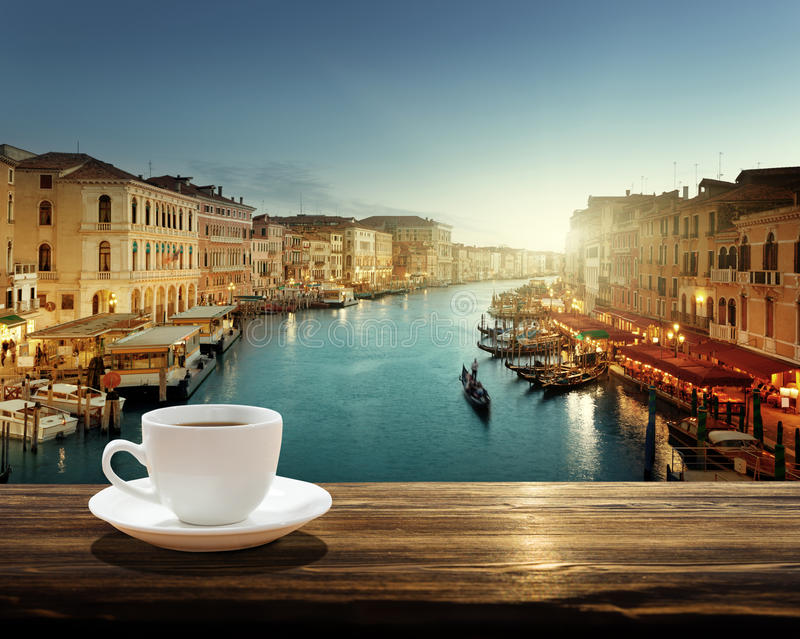 Coffee on table and Venice in sunset time, Italy. Europa stock image