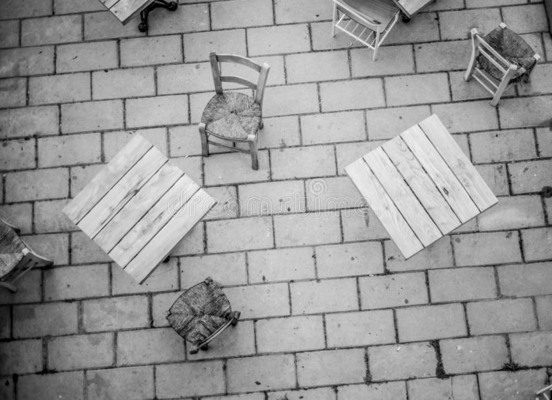 Coffee tables from above in black and white in a pedestrian street stock photo