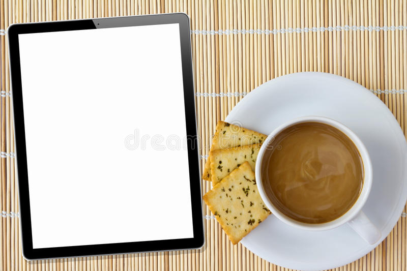 Coffee and Tablet. White porcelain cup. And three biscuit on a mat royalty free stock photos