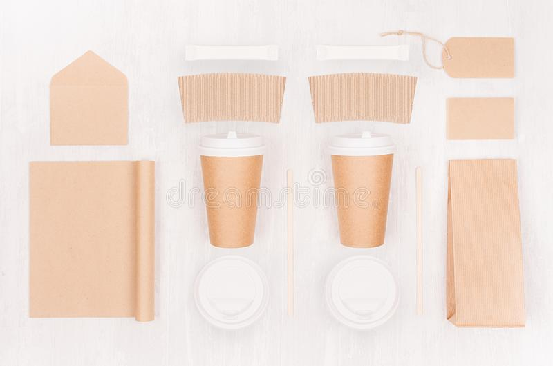 Coffee takeaway set mockup for brand - two brown paper cups with blank notebook, card, label, packet, sugar, cap, envelope. Coffee takeaway set mockup for brand royalty free stock photos