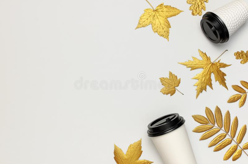 Coffee or tea paper cups, golden autumn leaves on light gray background top view flat lay. Take away coffee cup, mockup. Coffee. Love, layout for design. Fall stock photos
