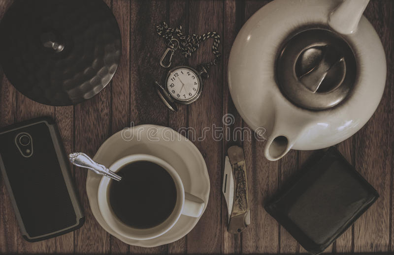 Coffee Tea Pot, Cup And Saucer, Pocket Knife And Watch, Wallet A stock photo