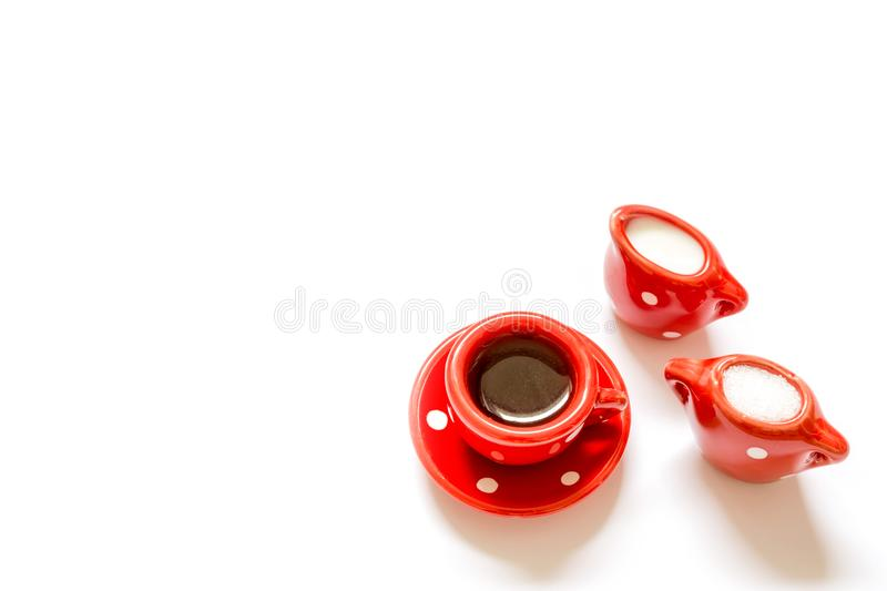 Coffee tea in red mug with a cup of milk and sugar isolated royalty free stock photo