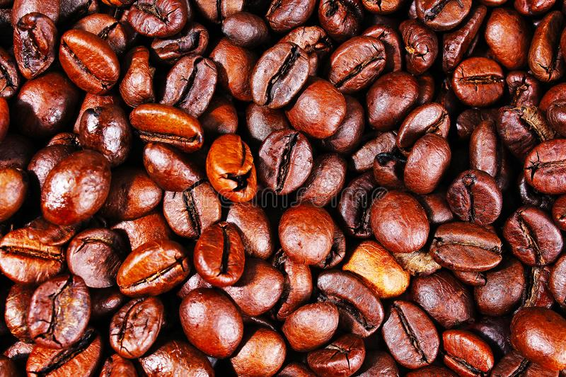 Coffee texture. Roasted coffee beans as background wallpaper. Beautiful arabica real cofee bean illustration for any royalty free stock photos