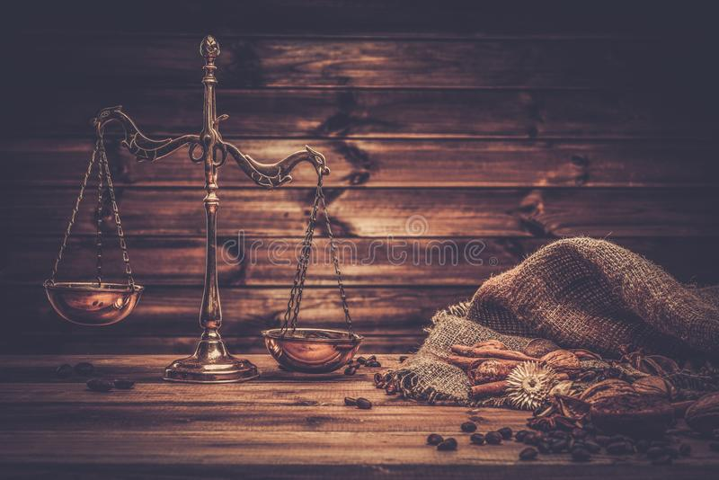 Coffee theme with brass scales. Still-life on wooden table stock photo