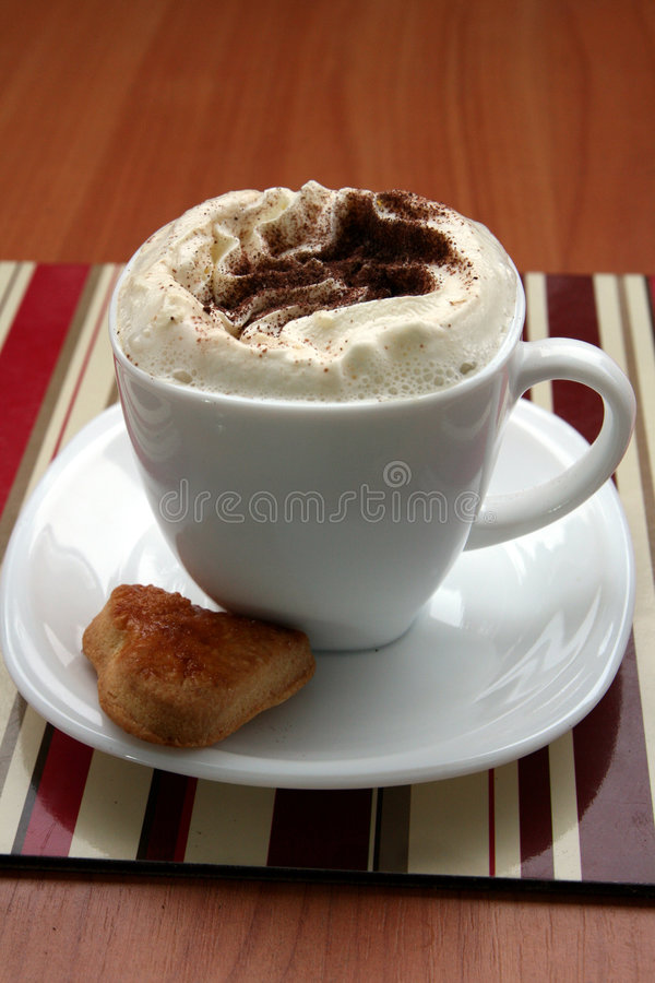 Coffee time. Cup of coffee with whipped cream, chocolate and heart cookie stock photography
