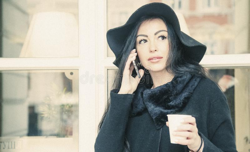 Coffee time. Business woman holding  phone and enjoying coffee i stock image