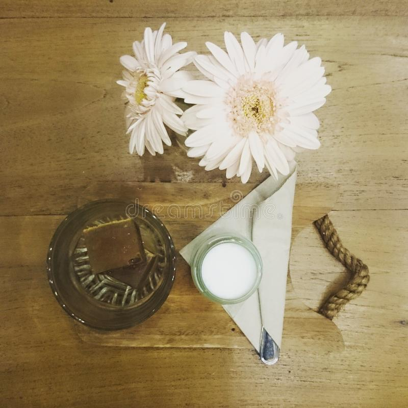 Coffee time cube milk flowers royalty free stock photography