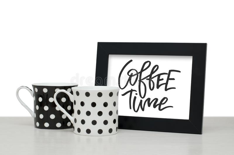 Coffee time. Handwritten text. Modern calligraphy. Black wooden royalty free stock image