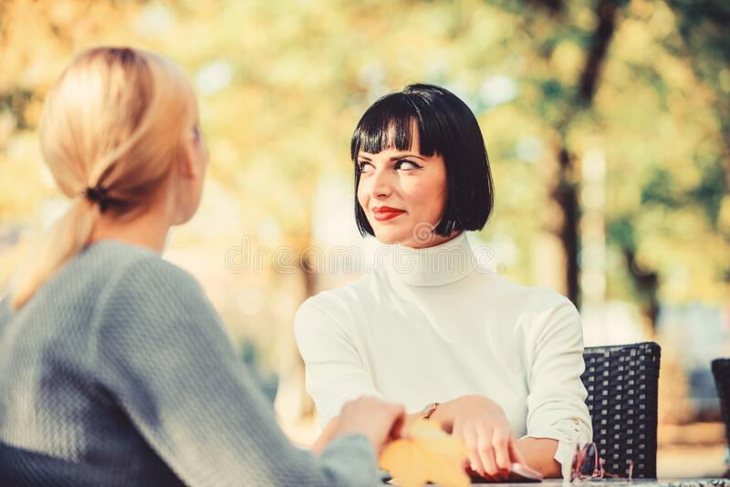Coffee time. Meeting in cafe. fashion beauty. bisiness lunch. happy friends girls meet in cafe. female frienship. Relax royalty free stock photography