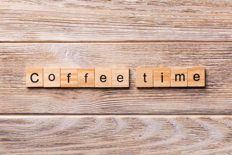 Coffee time word written on wood block. coffee time text on wooden table for your desing, concept.  stock image