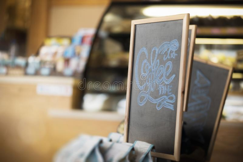 Coffee time written on a black chock board. royalty free stock image