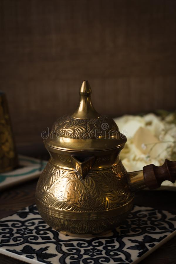 Coffee Turk on a ceramic stand on a wooden table stock photography