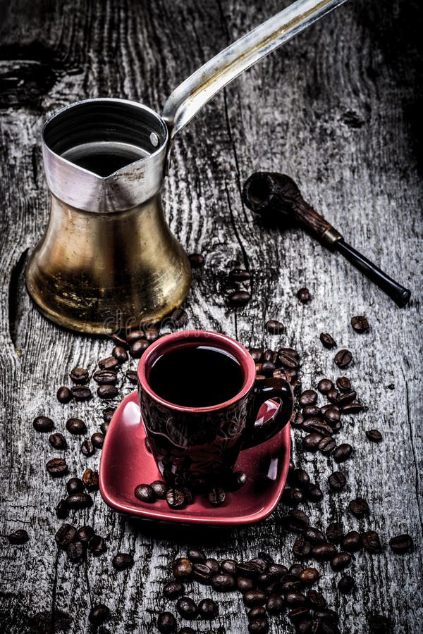 Coffee turk and cup and coffee beans on old gray wooden table. S royalty free stock photo