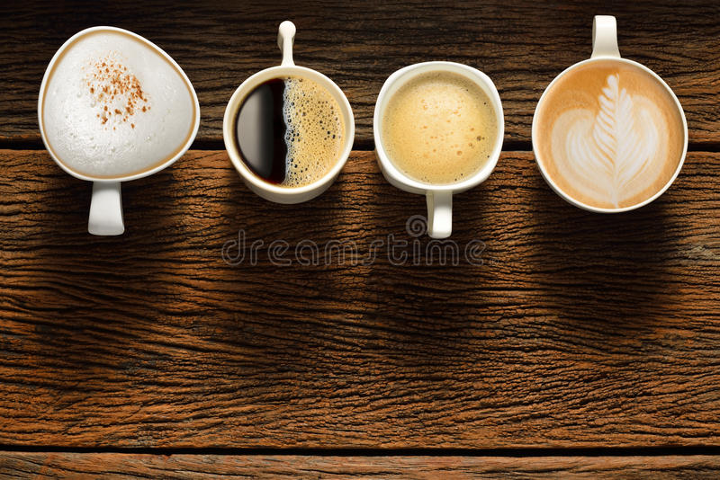 Coffee. Variety of cups of coffee on old wooden table royalty free stock photos