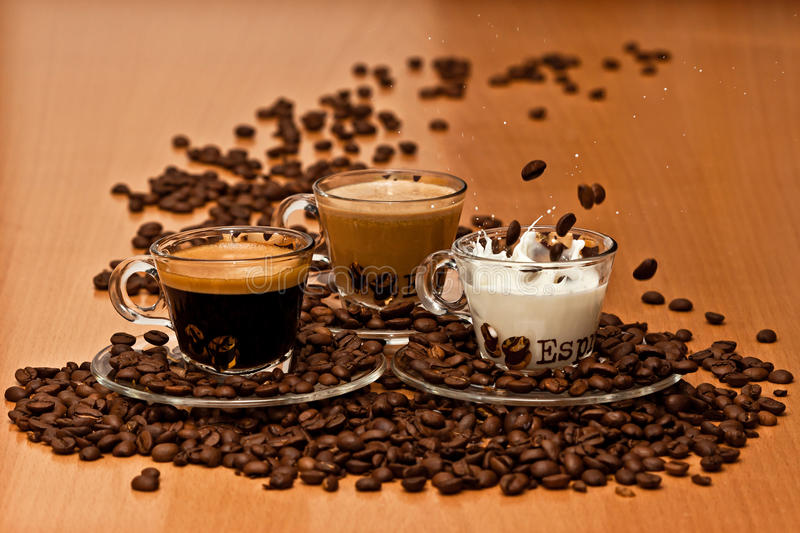 Coffee Variety. Coffee drops in Milk, a Variety of Coffee: Black, Milky, Milk royalty free stock photo