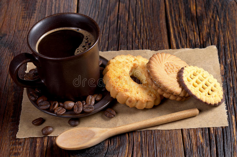 Coffee and various cookies stock images