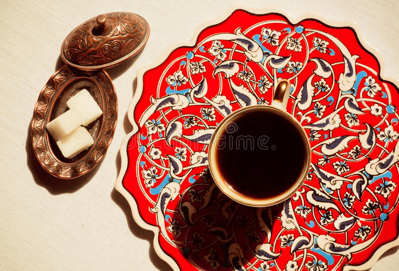 Coffee and vintage sugar bowl on a table stock image