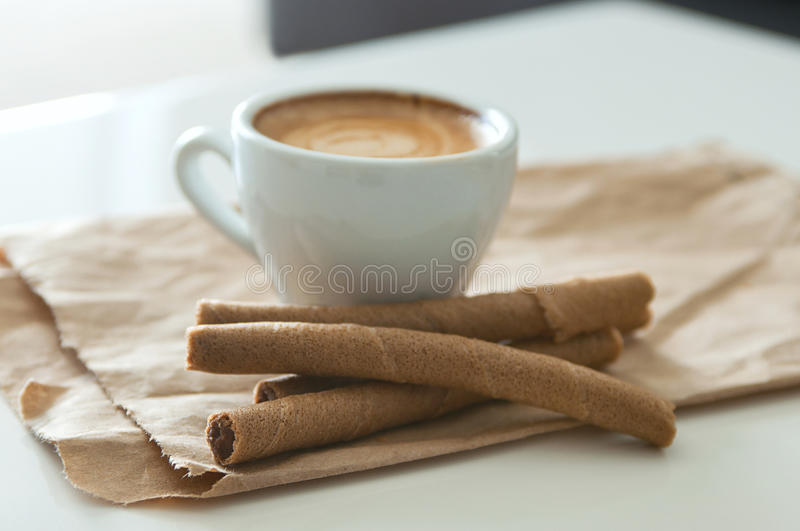 Coffee and wafer tubes royalty free stock images