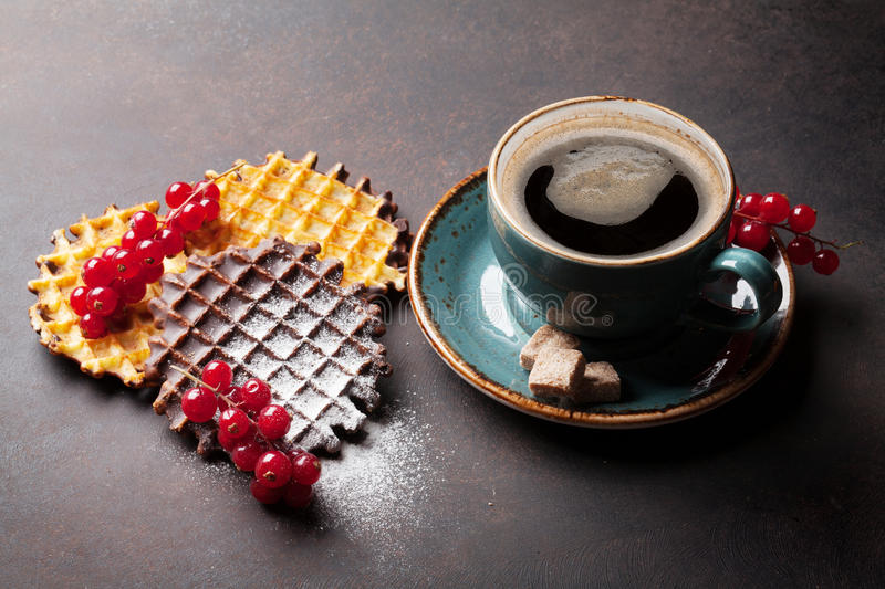 Coffee and waffles with berries. On stone table stock photography