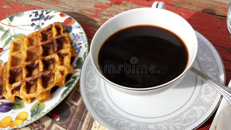 Coffee and waffles stock images