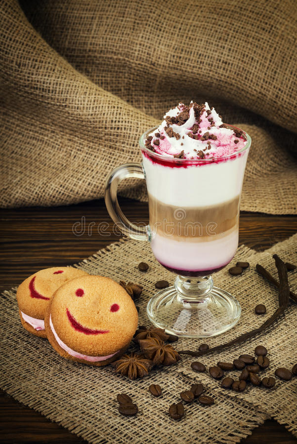 Coffee with whipped cream. And berry topping royalty free stock images