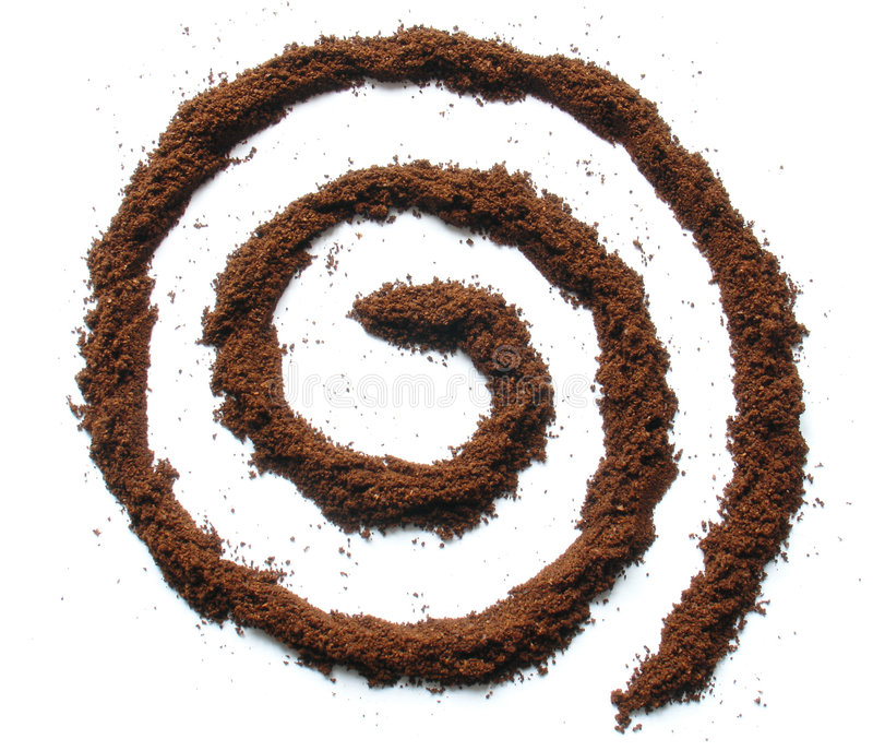 Coffee whirl. A whirl shape made out of coffee powder on white background royalty free stock photo