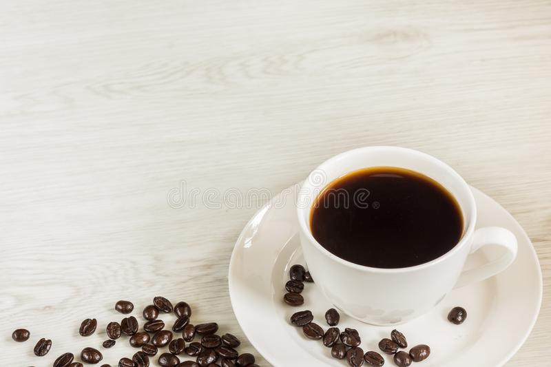 Coffee in white cup and coffee beans stock photos