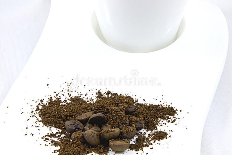 Coffee on a white plate royalty free stock images