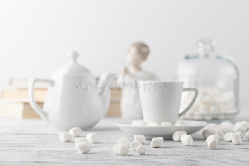 Coffee in white porcelain cup on wooden table stock photo