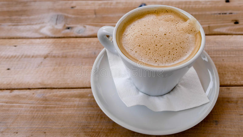 Coffee on wooden background royalty free stock images