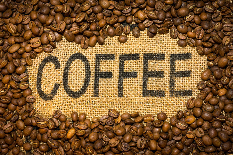 Coffee word and beans. Coffee word and brown beans stock photography