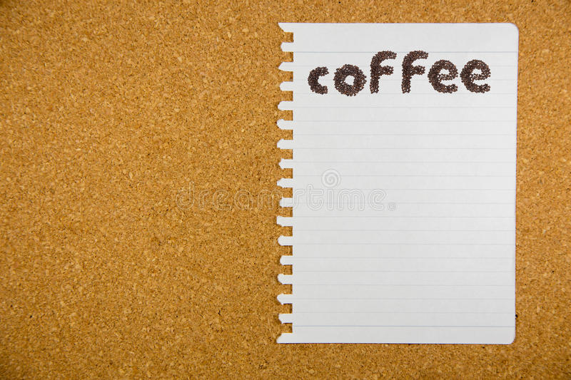 Coffee word made from coffee beans on paper royalty free stock photography