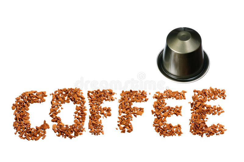 Coffee word. Written by coffee beans and capsule isolated on white background royalty free stock image