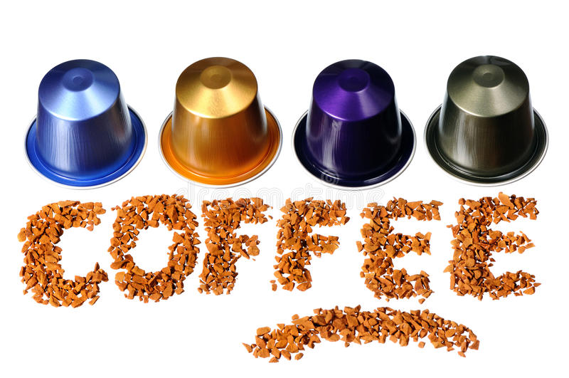 Coffee word. Written by coffee beans and capsules isolated on white background royalty free stock photo