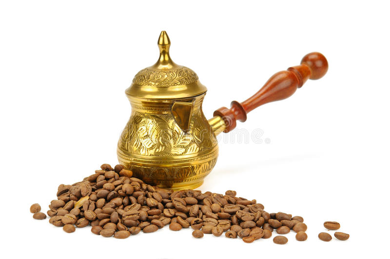Coffeepot and coffee beans on white background stock image