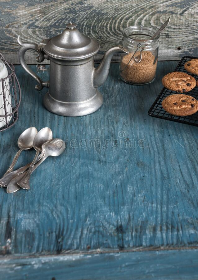 Coffeepot, milk and homemade oatmeal cookies royalty free stock images