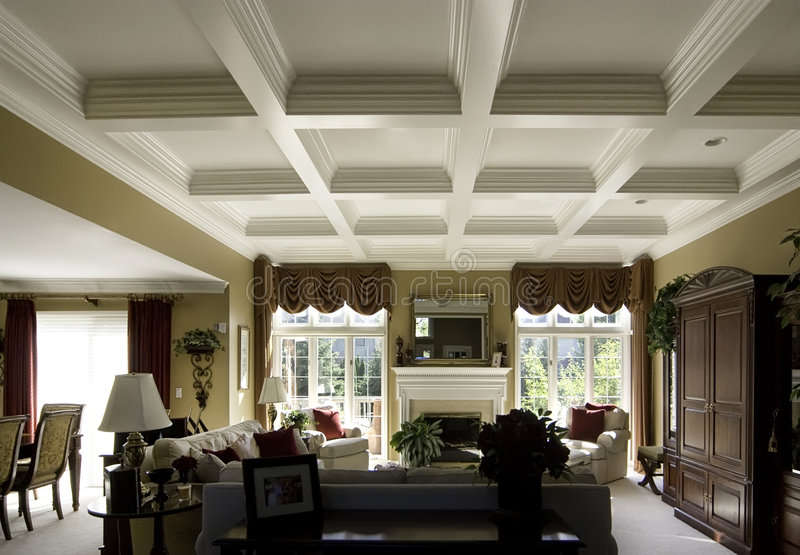 Coffered ceiling in a luxury home. Custom coffered ceiling in a luxury home living room royalty free stock images