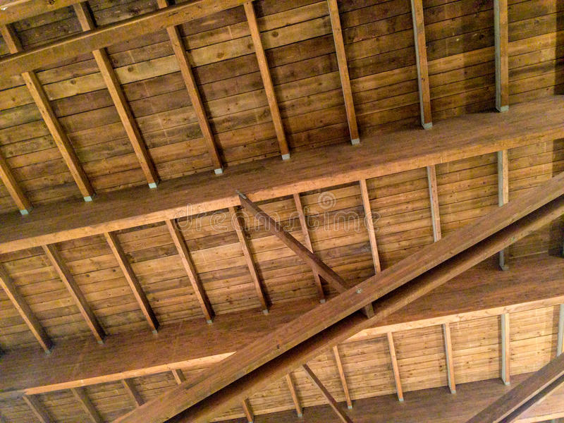 A coffered ceiling of wood. Old house with a coffered ceiling of wood stock photo