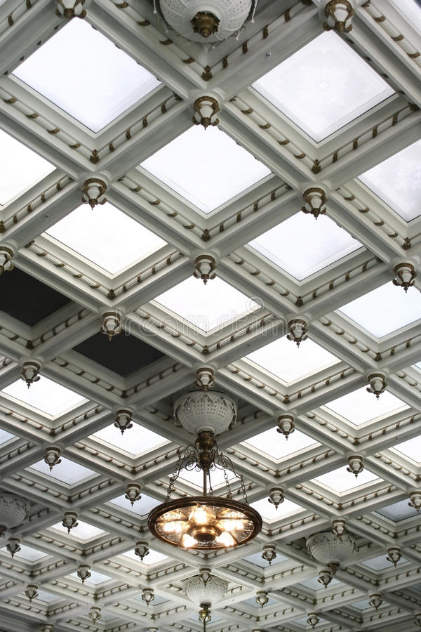 Coffered white ceiling. Beautiful coffered white ceiling with illuminated recessed panels stock photography