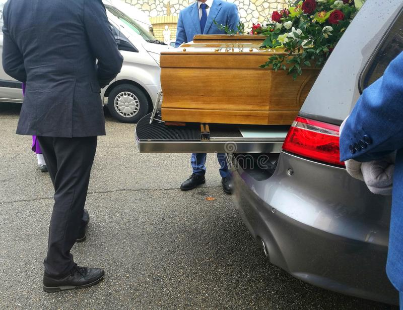 Coffin in the hearse stock images