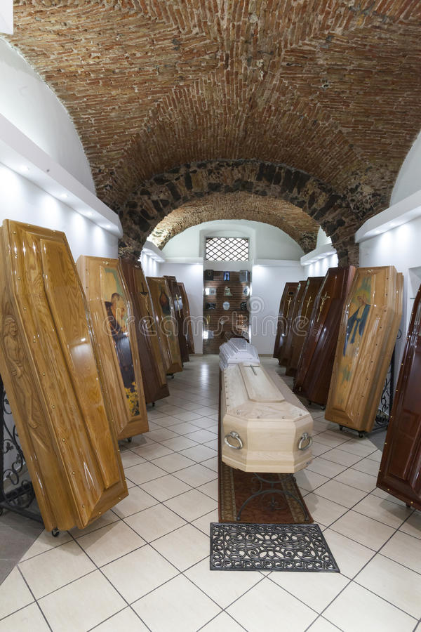 Coffin shop. Display of coffins. A shop in the historic center of Catania, Sicily (Italy) with several coffins on display. Some have a painting of saints on the royalty free stock photography