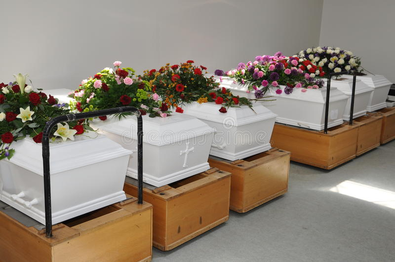Coffins. Six coffins waiting to be burned stock images